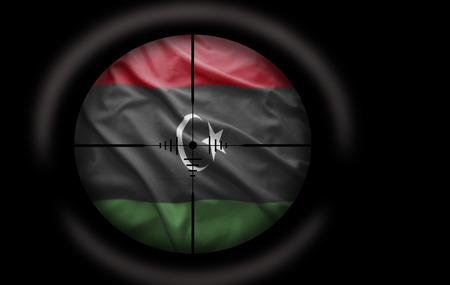 Sniper scope aimed at the Libyan flag photo