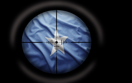 somalian: Sniper scope aimed at the Somalian flag