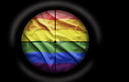 Sniper scope aimed at the Rainbow flag photo