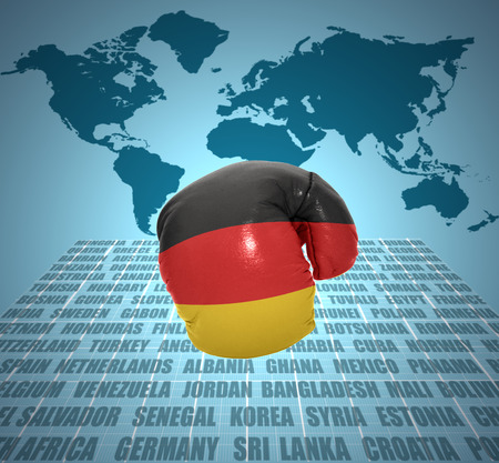 Boxing glove with the flag of Germany in motion on world map background photo