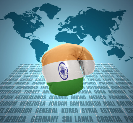 Boxing glove with the flag of India in motion on world map background photo