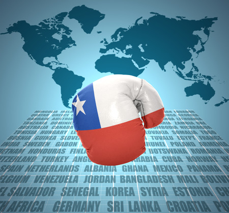 Boxing glove with the flag of Chile in motion on world map background photo