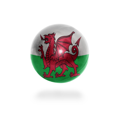 Flag of Wales on the ball isolated on white photo