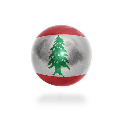 Flag of Lebanon on the ball isolated on white photo