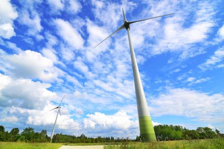 Wind turbine park against the blue sky and shining sun photo