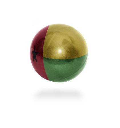 guinea bissau: Flag of Guinea Bissau on the ball isolated on white