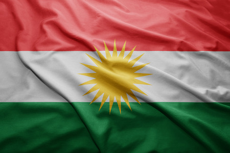 Waving colorful Kurdistan  flag photo