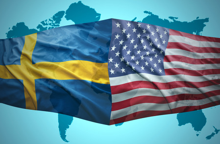 Waving Swedish and American flags of the political map of the world Stock Photo