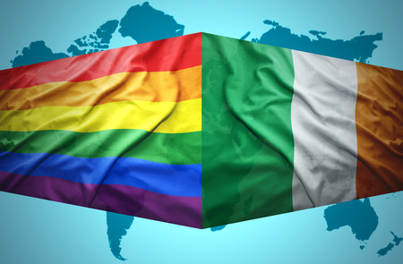 homosexual sex: Waving Irish and Gay flags of the political map of the world Stock Photo