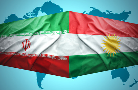 Waving Kurdish and Iranian flags of the political map of the world photo