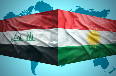 Waving Kurdish and Iraqi flags of the political map of the world photo