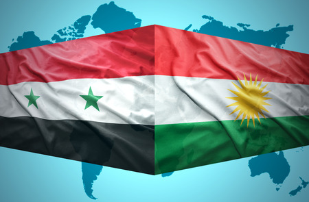Waving Kurdish and Syrian flags of the political map of the world photo