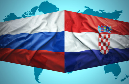 Waving Croatian and Russian flags of the political map of the world photo