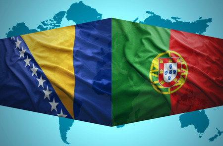 Waving Bosnian and Portuguese flags of the political map of the world photo