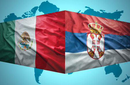 serbia: Waving Serbian and Mexican flags of the political map of the world