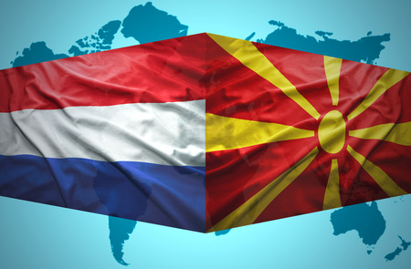 Waving Macedonian and Dutch flags of the political map of the world photo