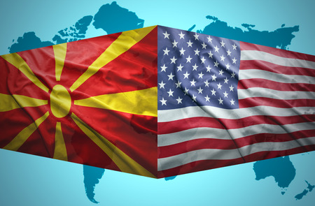 Waving Macedonian and American flags of the political map of the world photo