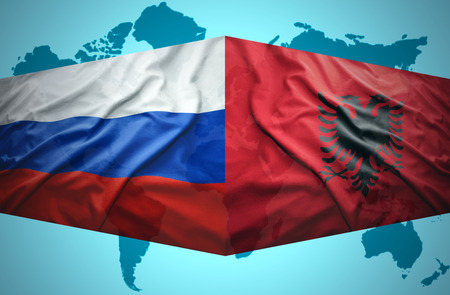 Waving Albanian and Russian flags of the political map of the world photo