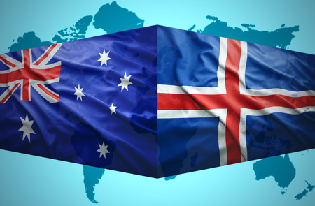 the icelandic flag: Waving Icelandic and Australian flags of the political map of the world