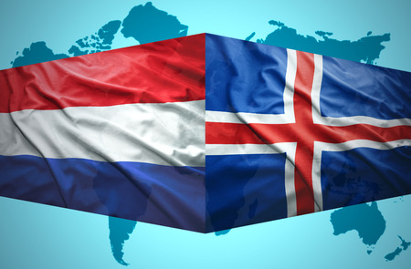 Waving Icelandic and Dutch flags of the political map of the world photo