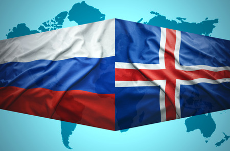 Waving Icelandic and Russian flags of the political map of the world photo