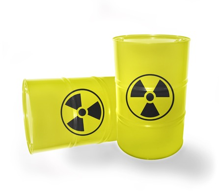 Yellow barrels with sign of radiation on the white photo