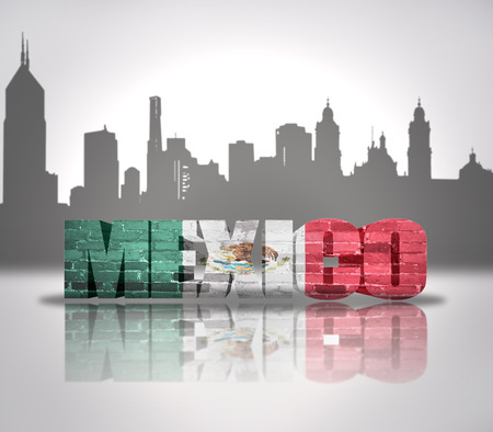 Word Mexico with national flag of Mexico near skyline silhouette photo