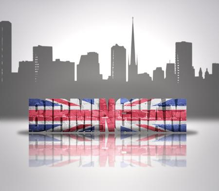 Word Birmingham with national flag of England near skyline silhouette photo