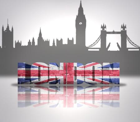 Word London with national flag of England near skyline silhouette photo