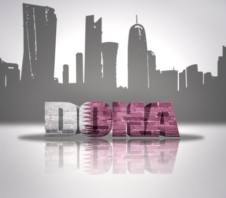 Word Doha with national flag of Qatar near skyline silhouette photo