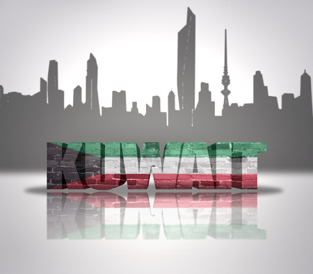 Word Kuwait with national flag of Kuwait near skyline silhouette photo