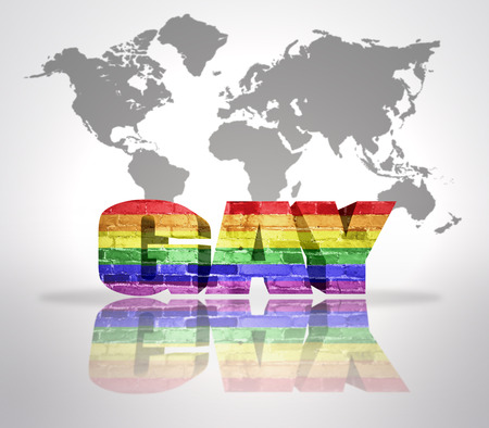 Text Gay with Rainbow Flag on a world map background photo