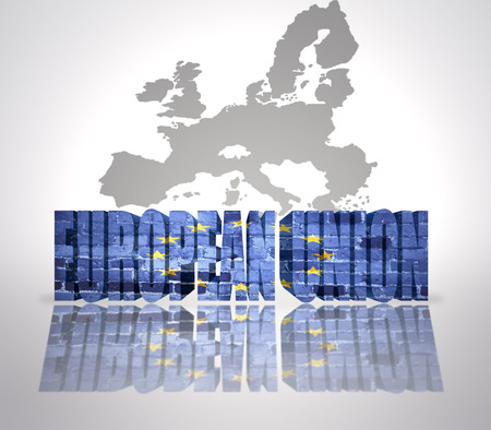 Text European Union with European Union Flag on a european union map background photo