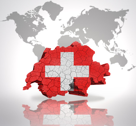 Map of Switzerland with Swiss Flag on a world map background photo