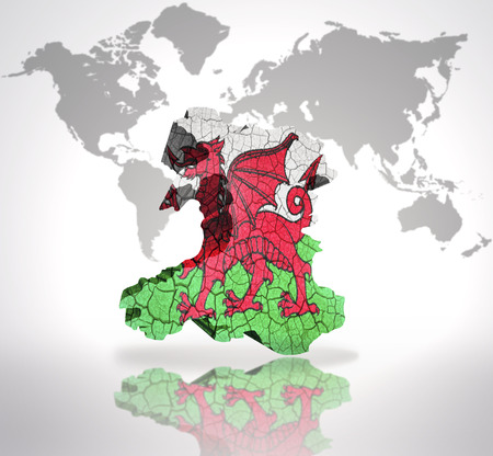 welsh flag: Map of Wales with Welsh Flag on a world map background