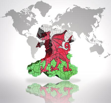 welsh flag: Mappa del Galles con Welsh Flag su una mappa del mondo di fondo