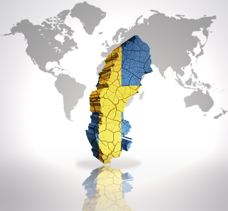 Map of Sweden with Swedish Flag on a world map background photo