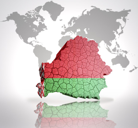 belorussian: Map of Belarus with Belorussian Flag on a world map background Stock Photo