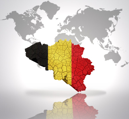 Map of Belgium with Belgian Flag on a world map background photo