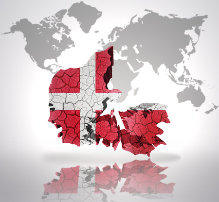 Map of Denmark with Danish Flag on a world map background photo