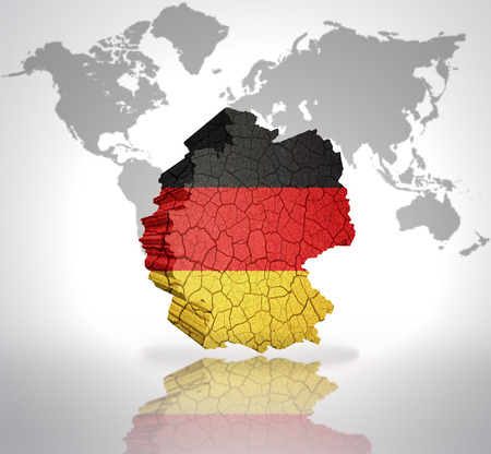 east berlin: Map of Germany with German Flag on a world map background