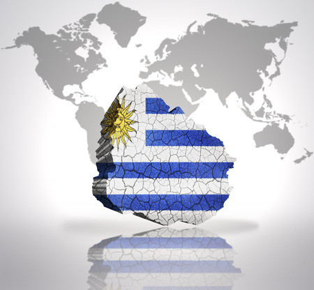Map of Uruguay with Uruguayan Flag on a world map background photo