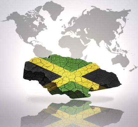 Map of Jamaica with Jamaican Flag on a world map background photo