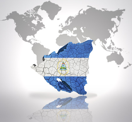 Map of Nicaragua with Nicaraguan Flag on a world map background photo