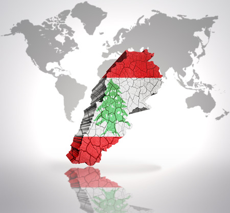 map of lebanon with lebanese flag on a world map background photo
