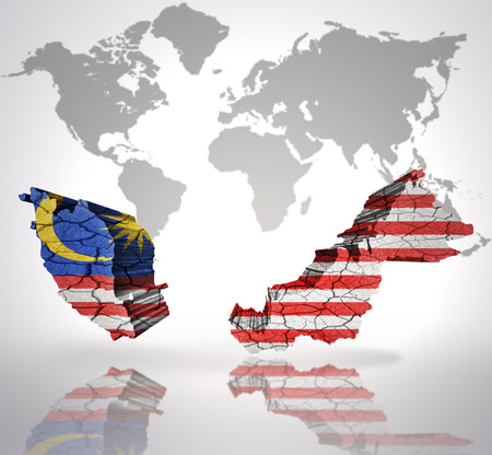 Map of Malaysia with Malaysian Flag on a world map background photo