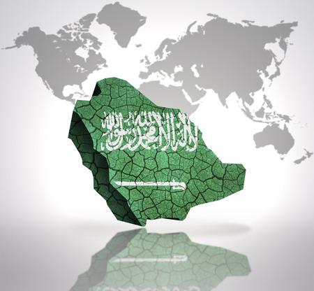 Map of Saudi Arabia with Saudi Arabia Flag on a world map background photo