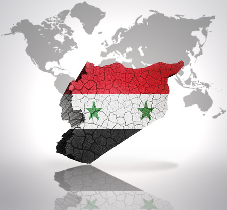 Map of Syria with Syrian Flag on a world map background photo