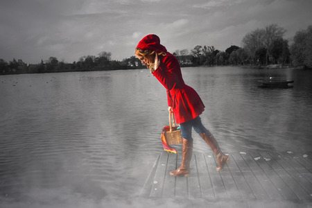 Little Red Riding Hood on a black-white background photo