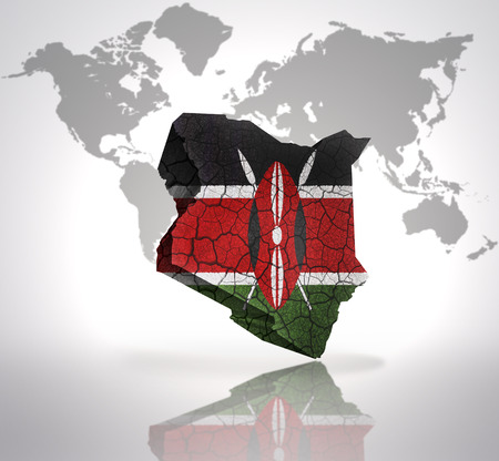 Map of Kenya with Kenyan Flag on a world map background photo